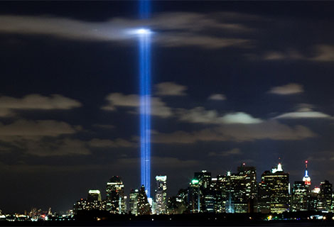 Lights depicting the fallen Word Trade Center towers shine from the ground to the sky