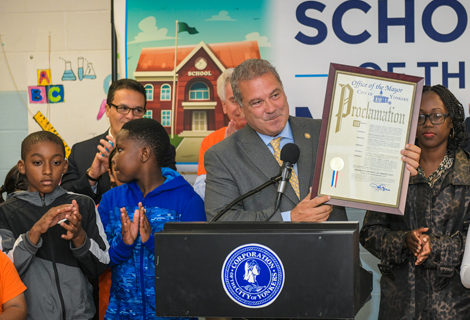 Mayor Mike Spano presenting proclamation to Cornell Academy