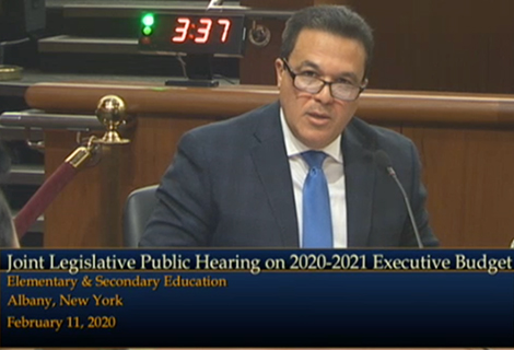 Superintendent of Schools Dr. Edwin M. Quezada testifying to joint legislative session